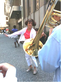 Sheila Collins dancing on the streets of Pittsburg